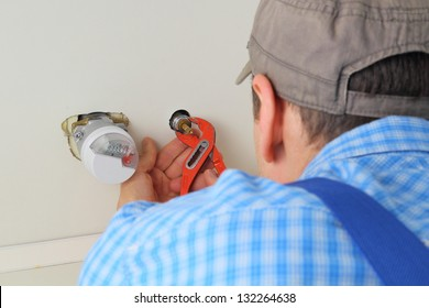 Plumber mointing water supply