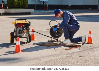 Plumber prepares to fix the problem in the sewer. Repair work on troubleshooting.
