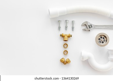 Plumber profession with gear and instruments for repair tubes on white background top view copyspace