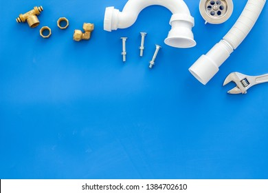 Plumber profession with gear and instruments for repair tubes on blue background top view copyspace