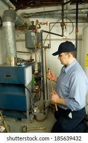 Plumber repairs gas furnace