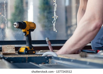 Plumber repairs the pipeline in the floor, replaces the old pipes with new copper, screwdriver, gas burner, soldering, construction professional tools, parts of pipes