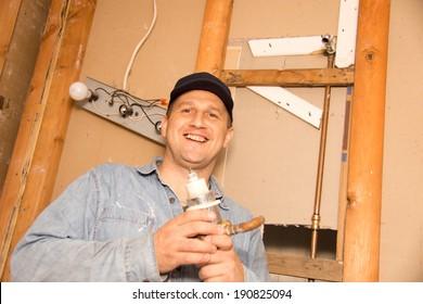 Plumber repairs shower