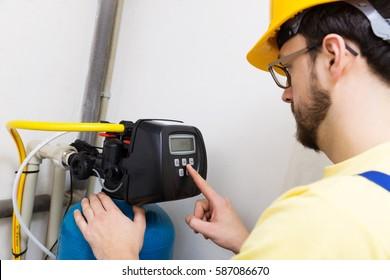 plumber set up water filtration system