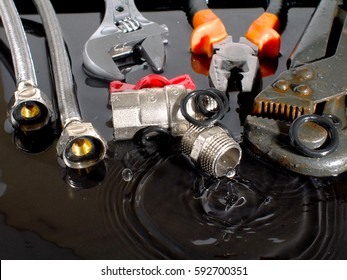 plumber tools and accessories in water