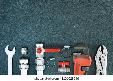 Plumber tools on concrete structure background with place for text.Top view.Home repair concept.