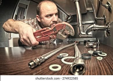 plumber at work indoor shot