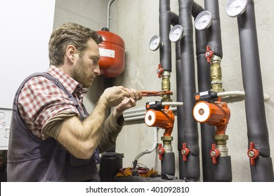 plumber at work installing a circulation pump
