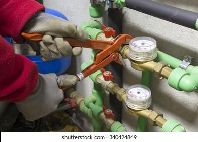 plumber at work installing a water meter