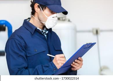 Plumber at work wearing a mask, coronavirus concept