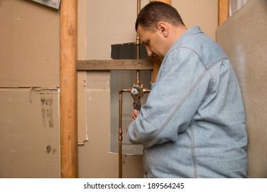 Plumber works in bathroom
