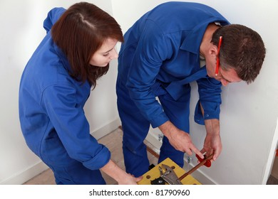 Plumber with young female apprentice
