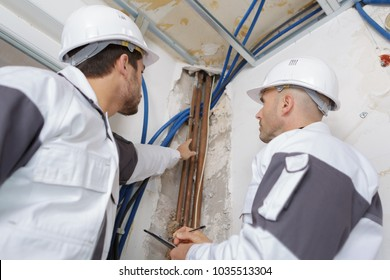 plumbers working in home being renovated