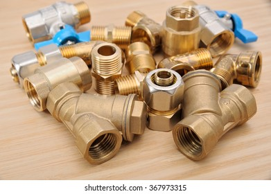 plumbing fittings on a wooden background