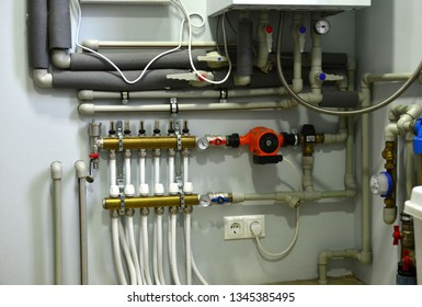 Plumbing, fixing pipes and fittings for connection of water or gas systems.  Heating system with plastic pipes, valves and other equipment in the boiler room.