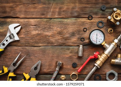 Plumbing flat lay background with copy space. Work tools and pipeline parts on plumber workbench.