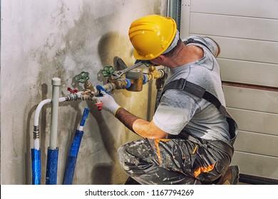 plumbing services, plumber at work