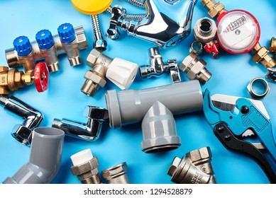 plumbing tools and equipment on blue background