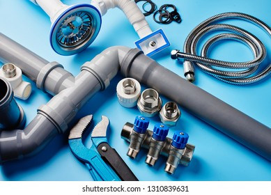 plumbing tools and equipment on blue background top view