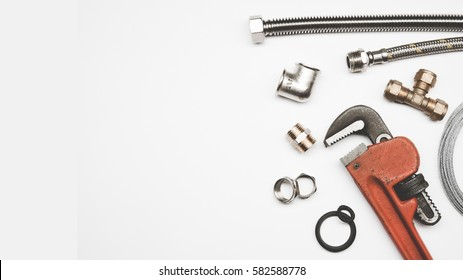 plumbing tools and equipment on white background with copy space