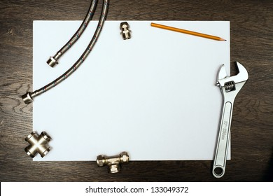 plumbing tools on a white sheet of paper, place for text