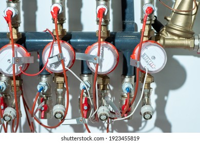 Plumbing wiring close-up. Fragment of a plumbing with several water meters. Concept installation of water pipes in private house. Mechanical devices for accounting of used water. Aqua meters on pipes