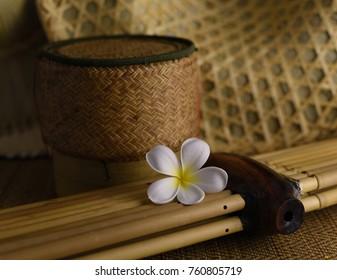 Plumeria with Lao reed mouthorgan