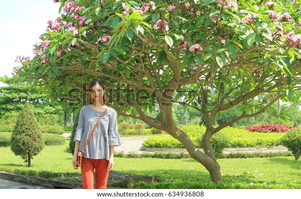 Plumeria with young girl in Thanh Hoa Vietnam