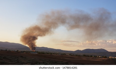 Plumes of smoke from a pallet company fire in Stead Reno area