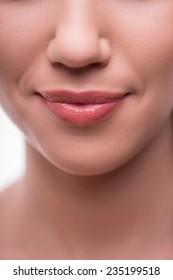 Plump  beautiful  girl lips smiling  isolated  on white background close up