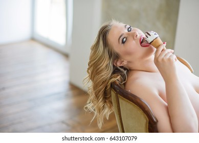 plump girl in the blue dress is sexy eating ice cream in a waffle Cup