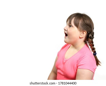 Plump girl opened her mouth in surprise and looks to the side of empty space. Isolated on white with copy space