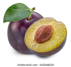 Plums half with leaves isolated on white background. Plums clipping path. Professional food shooting