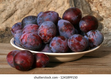 Plums from home orchard. Tasty and healthy snack on the farm. Set of fruits in the countryside.