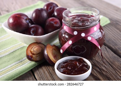 Plums Jam on old wooden table