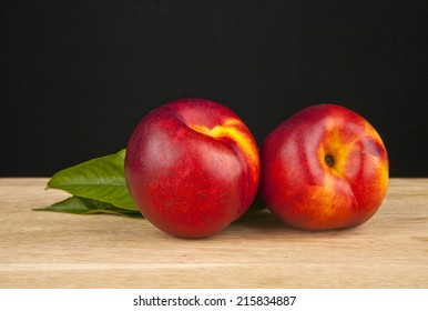 plums on a black background
