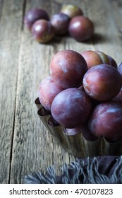 Plums on a rustic wooden table