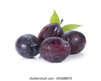 Plums plum prunes prune leaves fruits fruit isolated on a white background