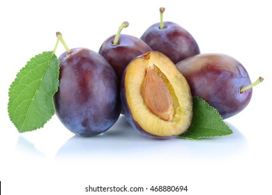 Plums plum prunes prune slice leaves fruits fruit isolated on a white background