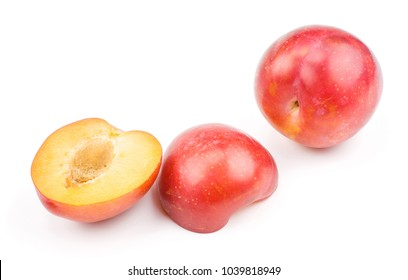 Plums red orange one whole two fleshy halves isolated on white background fresh and glossy