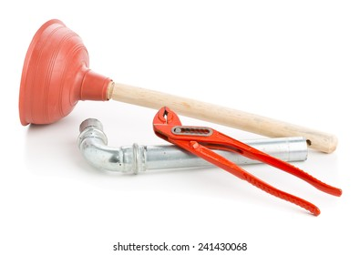 Plunger with wrench and pipe on white background