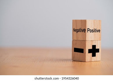 Plus and minus sign on wooden cube block ,Positive and negative thinking and mindset concept.