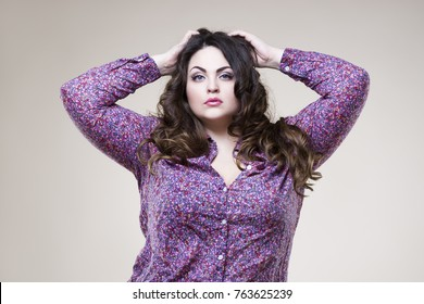Plus size fashion model in casual clothes, sexy fat woman on beige studio background