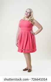 Plus size fashion model, fat woman on beige background, overweight female body, full length portrait