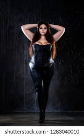 Plus size fashion model in sexy clothes, fat woman on black background, overweight female body, full length portrait