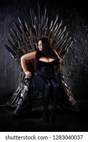 Plus size fashion model sitting on the iron throne, sexy woman in gothic interior, game of thrones cosplay