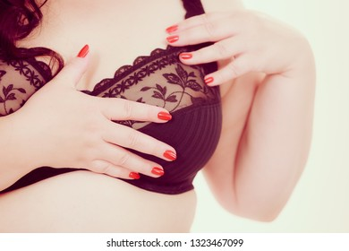Plus size fat mature unrecognizable woman wearing black lace soft bra. Female breast in lingerie. Bosom, brafitting and underwear concept.