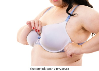 Plus size fat mature unrecognizable woman wearing bra, on white. Female breast in lingerie. Bosom, brafitting and underwear concept.