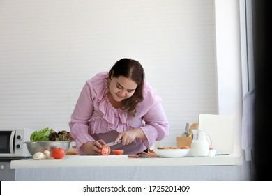Plus size, Fat woman prepare Salad and healthy meal , new normal clean food light style