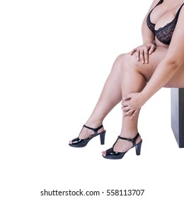 Plus size model in black high heels shoes, xxl woman isolated on white studio background, legs fatigue